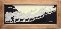 Swiss papercutting art (decoupage) featuring goats. I saw this in Switzerland and regret not buying it then.