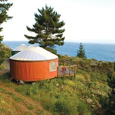 Treebones Resort, Big Sur, CA. Yurts with plush, queen-size beds piled with cozy comforters and colorful quilts, skylights for stargazing and decks for whale spotting
