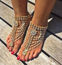 Shop Gold Barefoot Sandals for Weddings on the Beach. Gold Foot Jewelry for the Bride and Bridesmaids. Indian wedding Kundan Payal pearl Anklet with Toe Ring. Pearl beach Wedding Sandals with pearl detail. goddess Anklet with Toe Ring. Pearl Anklets. Beautiful Boho Chic Barefoot Sandals bling. Barefoot Bride wedding sandals. Vintage Bohemian Bride Accessories and ankle Foot jewelry bohemian barefoot shoes SHOP BODY KANDY COUTURE  For Barefoot Sandals, Kundan Payal ...