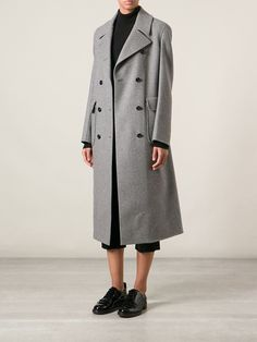 A men's coat. interesting contrast between the mens and womens coats for this collection. not sure why he is wearing shortened pants though. found on farfetch.com