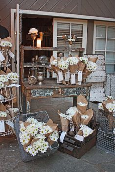 Wedding Reception corner vignette in a French market style with bunches of daisies for the guests to take home as a favor#wedding#favors- http://www.weddingboxvenice.com/ Your British/ American #wedding planning team based in the romantic city of Venice, Italy. #Wedding#planner#Venice Follow us on Pinterest! .