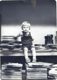 My big brother in the midst of a stack of vinyl records, late 1970s.   I love this picture!   Total old school  record store photo (our family business).