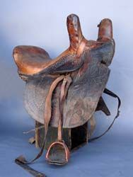 Antique women's side saddle in leather and wood