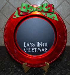 Red beaded or robe trim charger plate with black chalkboard vinyl . The chalkboard lets you fill in the blank to countdown to Christmas. This is