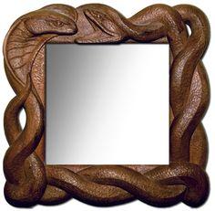 Zrcadlo Hadi 1, 2007 š: 50 x v: 50 cm, Dřevo lipové, mořené, vosková patina. Možnost vyrobit variantu v podobných tvarech a jiných barvách.