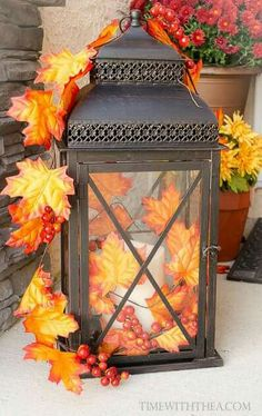 DIY Fall Mantel Ideas   Thanksgiving   Pinterest   Mini pumpkins     Fall Decorated Outdoor Lantern   Decorate a basic black outdoor lantern for  your front porch with inexpensive fall and berry garlands from the dollar  store