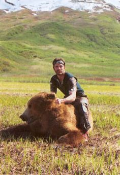 Guy on a grizzly bear.....