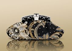 BVLGARI / Pochette in black damasco fabric embroidered with pearls and paillettes with palladium plated hardware.