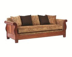 Amish Sleigh Sofa  at www.dutchcrafters.com ($2040 + $199 - cheaper than it was 5+ years ago)