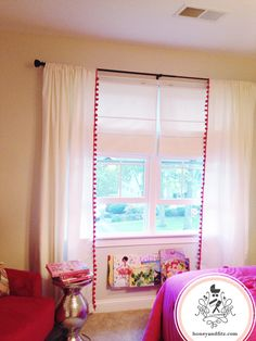 "DIY Ikea curtains with pom-pom fringe... also saw in some home insurance commercial where there were several larger pom poms ""strings"" just hanging over the curtains"