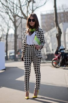 A geometric pant suit and neon accessories - need I say more?