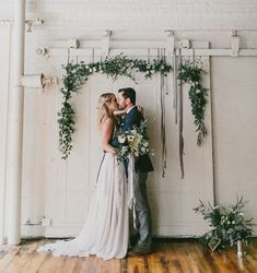 winter garland backdrop Winter Ocean wedding inspiration. florals by Carolyn Snell. Photo by Emily Delamater http://emilydelamater.com/