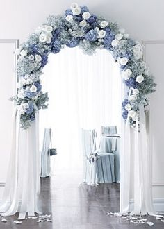 Set the scene for a dreamy reception space with a gorgeous blue and white arch entryway.