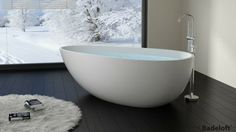 The is a large modern bathtub designed for your luxury bathroom.This freestanding tub is both peacefully tranquil and stylishly ergonomic. Deep Bathtub, Stone Bathtub, Modern Bathtub, Freestanding Bathtub, Unclog Bathtub Drain, Deco Cool, Stand Alone Tub, Contemporary Baths, Bathtub Remodel