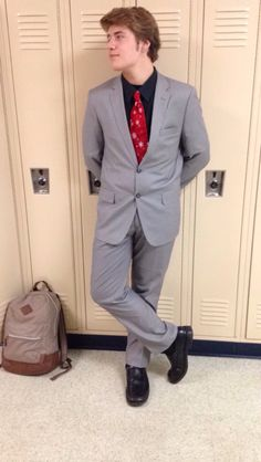 Today's outfit is a classy grey suit with. Black button up shirt and black shoes. A red Christmas tie to finish.