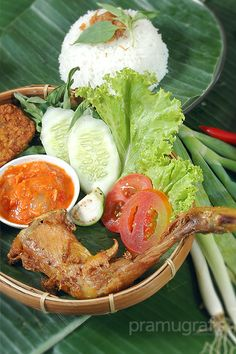 Pecel Ayam Goreng, a genuine traditional Indonesian food. Photoworks by agungpramudito