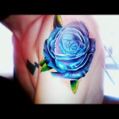 Blue and purple rose shoulder tattoo. The depth is amazing