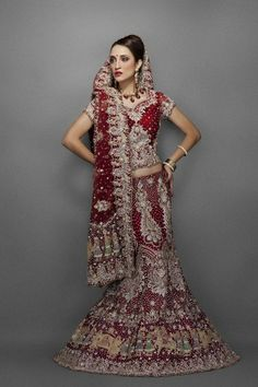 Maroon net bridal Lehenga with traditional embroidery