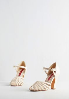 Sunporch Serenade Heel in Eggshell. Simultaneously steeping your morning tea as you mosey toward the sunroom, you notice the click of these glossy heels by Bait Footwear create a beat beneath the birds song. #white #prom #modcloth