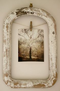 What a gorgeous idea. An old frame, a piece of twine, a peg and a photograph or postcard. Lovely!