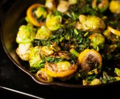 Pan fried lemon, Brussels sprouts and chard come together to make a quick side dish.