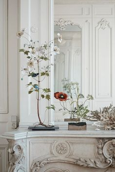 old world mantle with contemporary floral arrangement