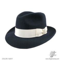 In the 1920′s the fedora hat was just entering the fashionable scene for men. Previously it was a women's style hat. 1920′s fedoras feature wide 3 inch brims that were shaped downward on both the front and back side. They also had a sharp crease down the middle that could be a single crease or a more triangle shape with the base of the triangle at the back of that hat. Hats came uncreased when purchased so that the owner could decide how to shape it. Popular colors were black and gray.