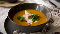 This Thai-inspired soup is loaded with intense and exotic flavours. It makes a perfect entree as is, or you could dress it up with some pan-seared prawns or . Coconut Recipes, Veg Recipes, Cooking Recipes, Recipies, Dinner Recipes, Roast Pumpkin Soup, Cooking For Three, Roasted Onions, Winter Soups