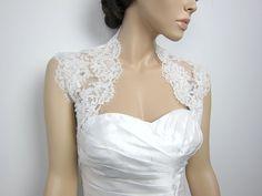 looooove.   Ivory sleeveless bridal bolero bridal jacket bridal by alexbridal, $74.99