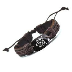 Two Stupid Cats ~ Products ~ Tiger Leather Bracelet   Wear it like you mean it with this extra cool and beautiful Tiger Leather Bracelet. Fine leather adorned with a dramatic tiger bead. Wear it like a tiger!