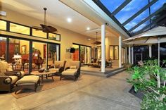 Outdoor Ceiling fan on covered porch. Great outdoor space.