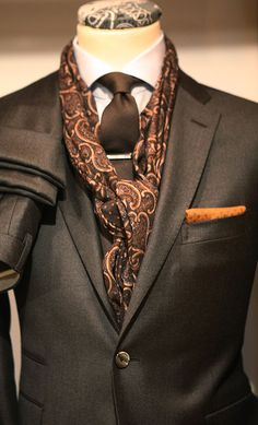 Paisley scarf and brown tone suit.