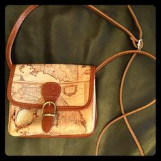 Leather vintage-map design Italian handbag purse Cute genuine Leather vintage-look-map design small Italian handbag purse. Front pocket, interior and small zipper pocket, adjustable strap, magnetized front clasp. 6.75 inches across 6.5 inches tall NWOT Vera Pelle Bags