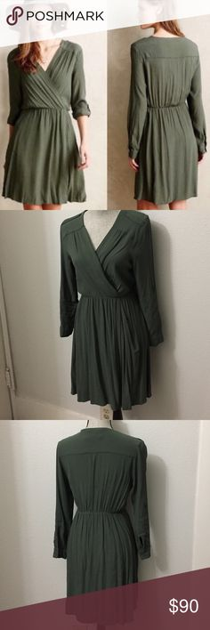 Anthropologie olive green utility wrap dress Worn once. It's too small from the chest area. I love this dress! I would like it in a small. In perfect condition. Zipper pockets and long sleeves that can be buttoned to be 3/4. Perfect olive green color for fall. Anthropologie Dresses