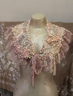 Inspired by soft blush pink shades, ornate antique laces and winter sunrise.. Luxurious and unique textile art collar is made of precious antique laces, which date back to the Victorian era- fine irish crochet, guipure, cotton net and vintage alencon lace. The laces are nuno felted and some appliques hand sewn- like antique silk applique from 1920 gown and crocheted piece from silk jabot with silk fringes. The collar is accentuated with hand stitches in blush pink wool, dimensional vintage…