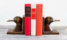 Vintage Pair of Wood & Brass Mid-Century Duck Bookends by TheRubberSol on Etsy https://www.etsy.com/listing/240330763/vintage-pair-of-wood-brass-mid-century