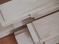 finish-grade, maple hardwood plywood planks  (a.k.a. smooth maple plywood),   8 sheets of maple plywood ripped into sixty four 6-inch wide planks.