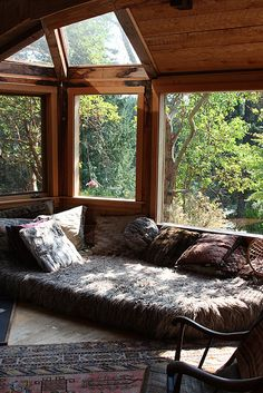 Low sofa in wooden cabin
