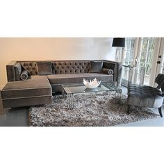 Tobias lush lavish hand tufted sectional, plush grey micro-velvet fabric contrasting piping, hardwood frame construction and long lasting high density foam for a firm support seat and back cushion. Chrome steel legs and beautiful bolster pillows.