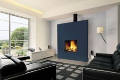Contemporary fireplace (wood-burning closed hearth) - UNIFOCUS - ArchiExpo
