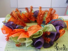 Halloween Chandelier Tutorial using a Copper Work Wreath, Paper Mesh, Burlap Ribbon and RAZ Animated Musicals...see more images and instructions on the Trendy Tree Blog http://www.trendytree.com/blog/halloween-chandelier-tutorial/