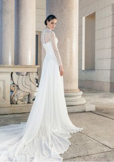 Wedding dress with a long train, long sleeves and a high collar from crochet Giuseppe Papini