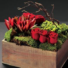 Design mini landscapes in planter boxes for centerpieces. Red, green, branches.