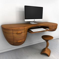 Swerve Desk: Marvel at the smooth soft curves of this floating table, how it gently emerges from the wall, how it holds on to it so elegantly. The texture and wood grain are exquisite, the drawers and pulls fitted fluidly and seamlessly. A truly gorgeous piece.