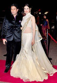 Bhushan Kumar and Divya Khosla Kumar at Arpita Khan's wedding reception in Mumbai. #Bollywood #Fashion #Style #Beauty
