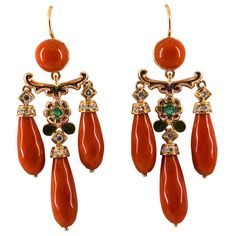 These Lever-Back Earrings are made of 14K Yellow Gold. These Earrings have 0.26 Carats of White Diamonds. These Earrings have 0.18 Carats of Emeralds. These Earrings have Red Mediterranean (Sardinia, Italy) Coral and Enamel. All our Earrings have pins for pierced ears but we can change the closure and make any of our Earrings suitable even for non-pierced ears. We're a workshop so every piece is handmade, customizable and resizable.