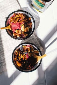 two bowls of blackberry acai frozen yogurt with a bottle of pompeian olive oil basking in the sun