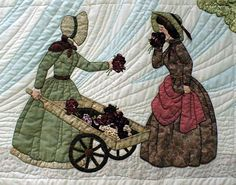 """#14 """"The Bonnet Girls Neighborhood & Town""""   Flower Girl Pattern $13.50.    The Bonnet Girls Neighborhood & Town  Flora takes her flower cart to the residential area and offers to let Lynette smell her floral bouquet.    The cart and the wheels are made of scraps rather than embroidery.    Heavy shadow appliqué in the sky makes it appear windy."""