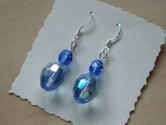 Sterling Silver earrings with small blue glass crystals and larger multi coated blue crystals