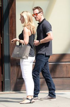 Michael Fassbender's manager lady has the best job in the whole wide wide world! She gets to shop, travel the planet, and be Fassy's minder!
